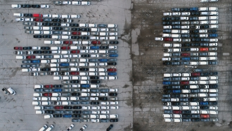 Cars parked outisde a General Motors assembly plant.