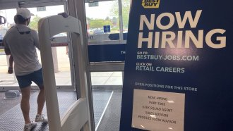 A hiring sign is seen at a retail store