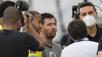 Argentina's Lionel Messi, center, Brazil's Neymar, left, and Argentina's coach Lionel Scaloni talk.