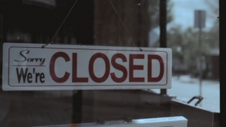 A closed sign in a business's window.