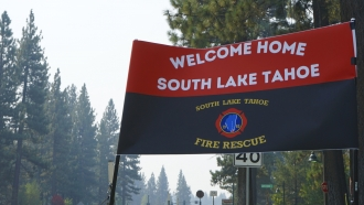 A sign outside a South Lake Tahoe Fire Station welcomes people back after the lifting of the evacuation order Monday.