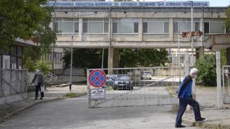 Men walk outside the state hospital in Veliko Tarnovo, Bulgaria.