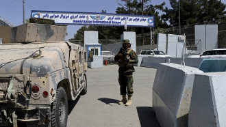 A Taliban soldier stands guard at the gate of Hamid Karzai International Airport in Kabul, Afghanistan, Sunday, Sept. 5, 2021
