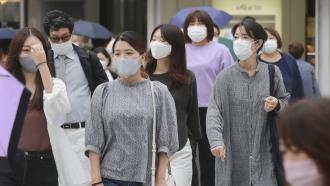 People wearing face masks in Tokyo, Japan.