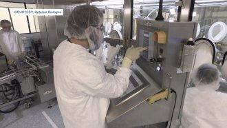 Man touches a machine screen.