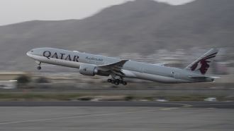 A Qatar Airways passenger plane takes off with foreigners from the airport in Kabul, Afghanistan.