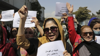 Women gather to demand their rights under the Taliban rule during a protest in Kabul, Afghanistan