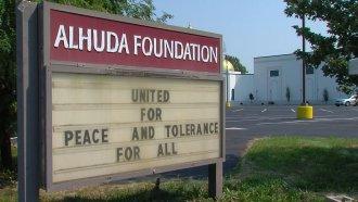Al Huda Foundation sign.