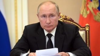 Russian President Vladimir Putin speaks during a meeting in Moscow, Russia.