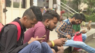 People using cellphones to view social media