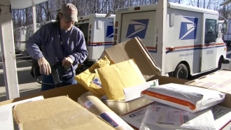 Man pushes packages.