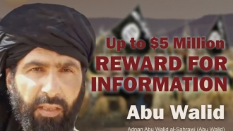 Undated image provided by Rewards For Justice shows a wanted poster of Adnan Abu Walid al-Sahrawi.