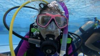 Girl Scuba Dives