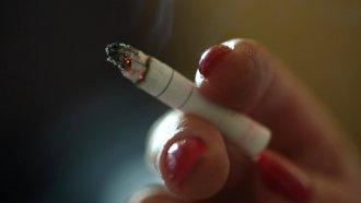 Person holds a cigarette.