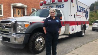A paramedic stands by an ambulance.