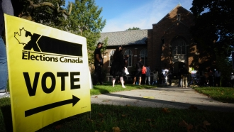 People line up for the Canadian general election.