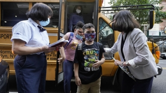 Students greeted as they arrive to school in New York City.