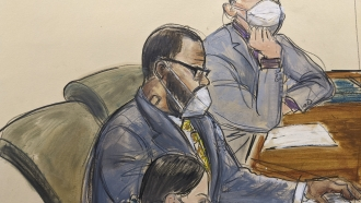 Courtroom sketch of R. Kelly sitting with his defense attorneys.