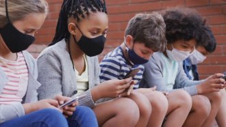 Kids use phones.