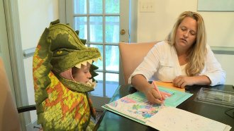 Mom and daughter draw in a book.