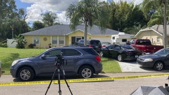 Police tape blocks off the home of Brian Laundrie's parents in North Port, Florida.