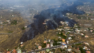 Lava from a volcano eruption flows destroying houses on the island of La Palma in the Canaries, Spain.