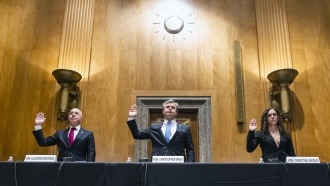Alejandro Mayorkas, left, Christopher Wray, center, and Christine Abizaid, right, are sworn-in prior to testifying