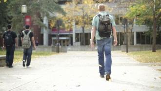 Student walks on campus.