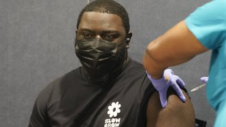 A Florida college student receives a COVID-19 vaccine.
