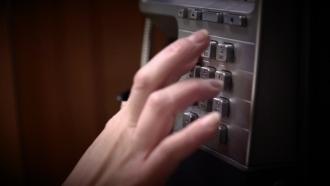 Person dials a phone