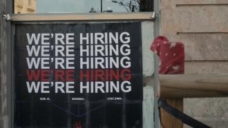 """We're hiring"" sign."