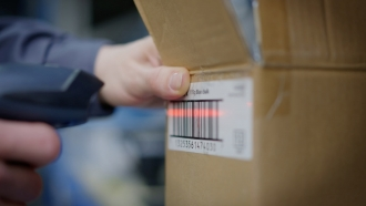 Warehouse worker scans a package.