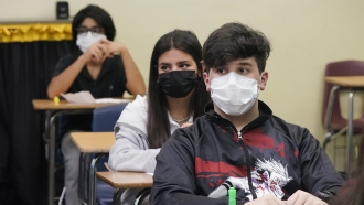 High school students wearing face masks in a classroom.