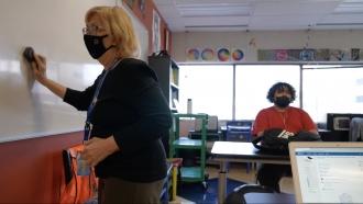 Substitute teacher in a classroom.
