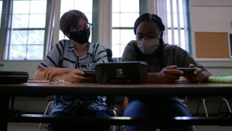 Students play video games in class