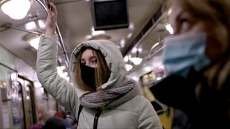 People wear masks on public transit.
