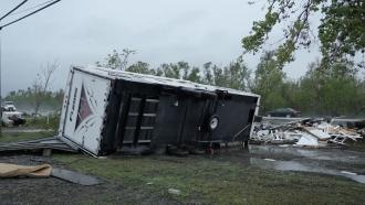 A trailer lies on its side after Hurricane Ida