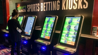 A man places a bet at one of the new sports wagering kiosks