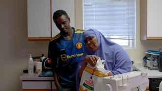 A refugee mother and son in their kitchen in North Dakota