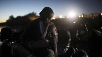 Migrants, most from Haiti, cross the Rio Grande towards Del Rio, Texas, from Ciudad Acuña, Mexico