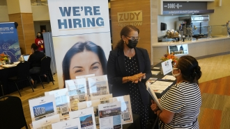 Human resources recruiter speaks during a job fair.