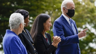 President Joe Biden gestures on the North Lawn of the White House