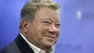 Actor William Shatner takes questions from reporters.