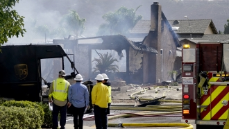 A home is destroyed after a plane crashed into it in Santee, California.