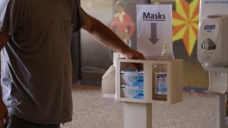 A man picks up a mask