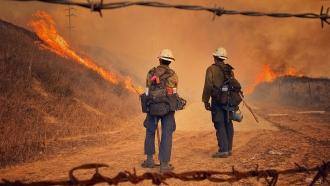 Firefighters battle the Alisal Fire in Santa Barbara County, California.