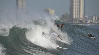 People surf in Mazatlan, Mexico.