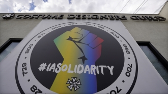 A poster advocating union solidarity hangs from a Costume Designers Guild office building in Burbank, Calif.