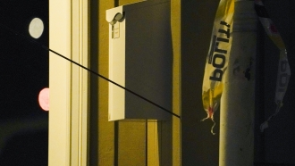 An arrow is seen in the wall after an attack in Kongsberg, Norway.