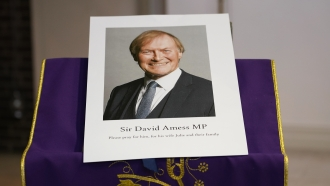 An image of murdered British Conservative lawmaker David Amess is displayed near the altar in St Peters Catholic Church